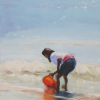 A young girl is concentrating on catching the waves with her bright orange plastic sandpail
